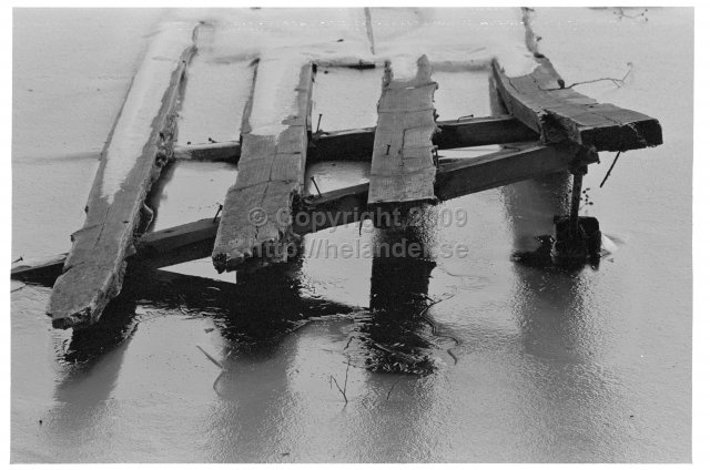 Old bridge in the ice. (1973)